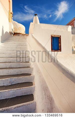 Narrow stairs in Oia Santorini. Shot at sunrise.