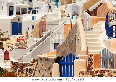 Close up of the narrow streets small doors and steep stairs of Oia town Santorini Greece