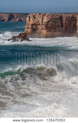 Storm waves beat against the rocks. Sagres in Portugal.