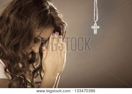 Woman Praying To God Jesus With Cross Necklace.