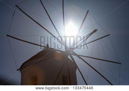 Windmill in Oia at sunrise Santorini Greece