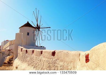 Windmill in Oia Santorini. Shot at sunrise. Horizontal shot