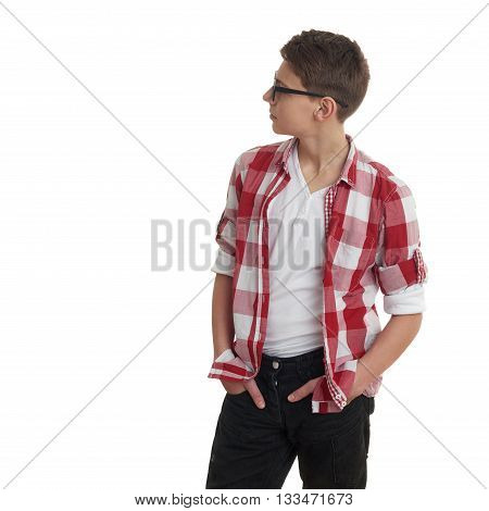 Cute teenager boy in red checkered shirt and glasses looking side over white isolated background, half body