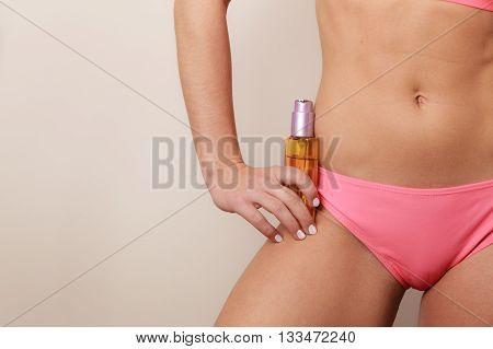 Woman Applying Moisturizing Body Oil Lotion