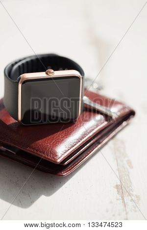 Smart Watches, Keys And Brown Leather Wallet