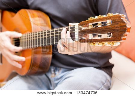 Guy with acousting guitar player performance style