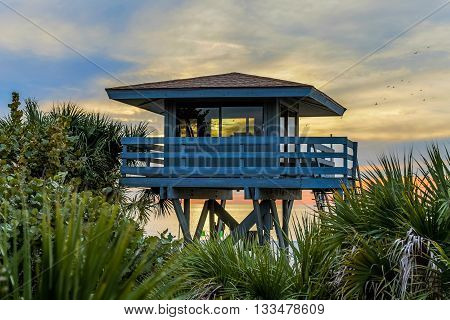 Sunset view of a lifeguard station in the tropics.