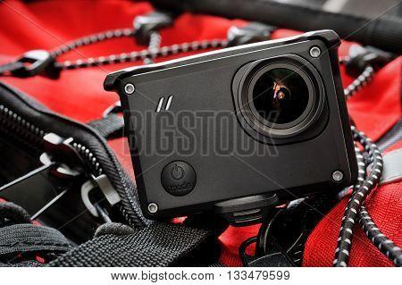 Action sport camera on adventure equipment background