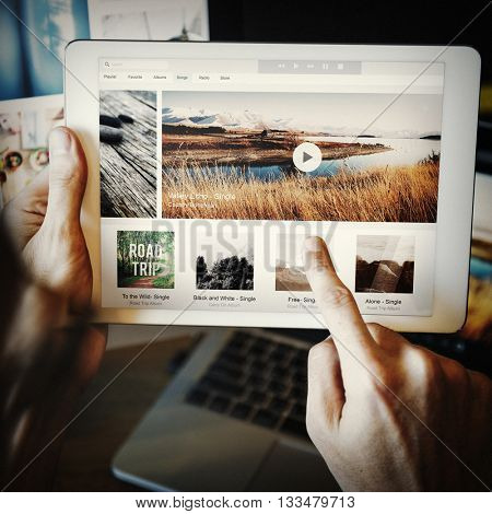 Technology Tab Choosing Music Playlist Concept