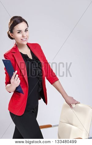 Portrait of Business Woman With Flat Planner.Posing Against White. Vertical Image