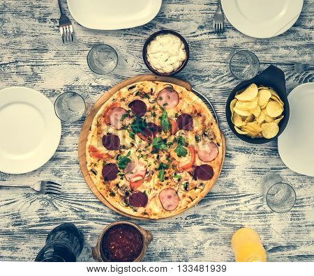 pizza on a table and plates top view