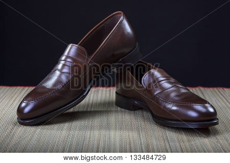 Footwear Concepts and Ideas. Pair of Stylish Expensive Modern Calf Leather Brown Penny Loafers Shoes.Closeup Shot. Horizontal Image Orientation