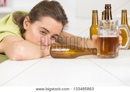 drunk woman slumped on table