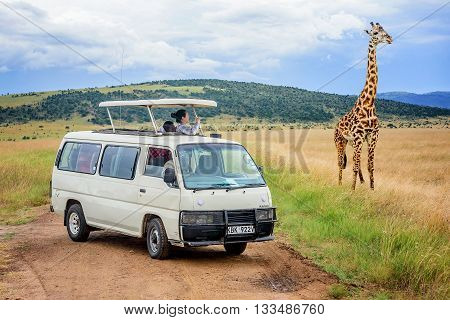 Kenya, Africa - March 7, 2016: People taking pictures of wild animals on a Safari tours in Kenya Africa