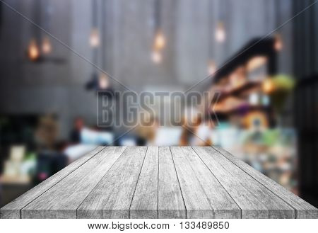 Black and white table top wooden with blurred background in coffee shop, stock photo