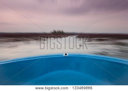Small boat in the lake of red lotus with blur background, stock photo