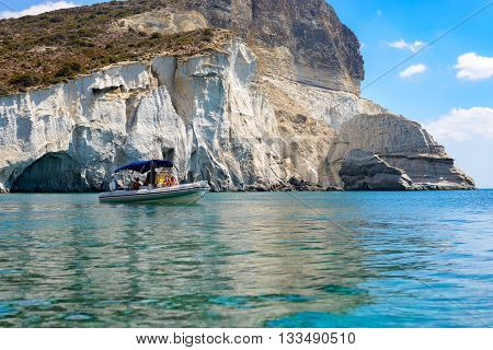 MELOS GREECE - SEPTEMBER 4 2012: Inflatable boat with people relaxing at Gerontas cove.