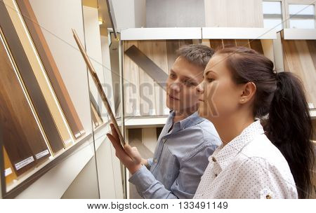 Couple shopping parquet in hardware store, shop for construction
