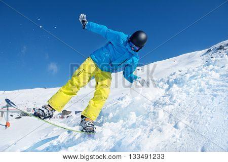 Man on the snowboard - at a ski resort