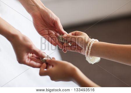 Wedding earrings on a female hand, she takes the earrings