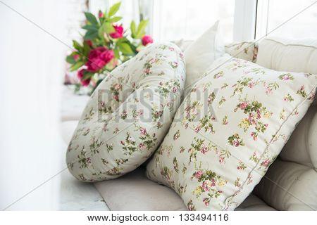 Pillows On The Windowsill And Plastic Window