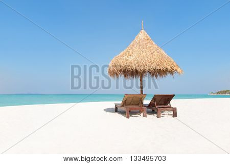 Wooden Deckchairs Under Traditional Straw Parasol On Paradise Beach.