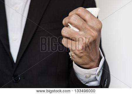 Businessman squeeze paper , hand close up