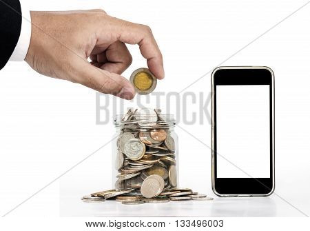 Hand putting coin and glass jar full of coins with mobile phone, isolated screen for copy space