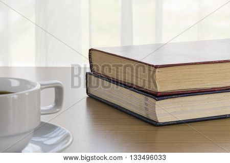 Book And Coffee Cup On A Wood Table