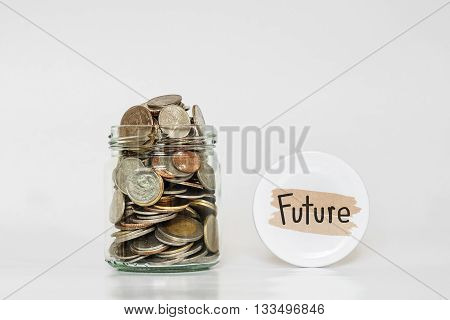Coins in glass jar, saving money for Future