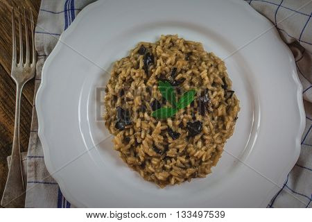 Traditional italian risotto with mushroom on white plate