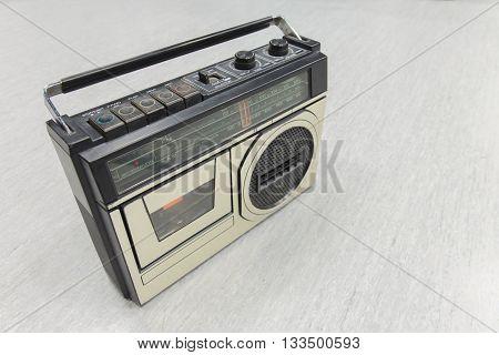 Retro radio on background. Old technology .