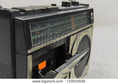 slot retro radio on background . Old technology .