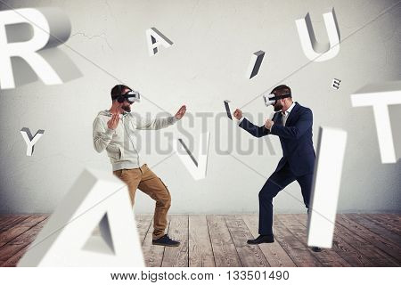 Two men, one in casual clothes, another in dark business suit, are wearing virtual reality glasses and standing in fighting poses ready to start their combat surrounded by flying letters
