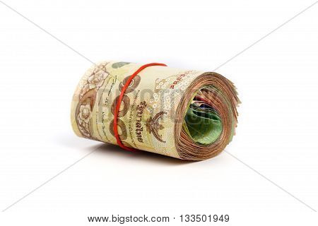Roll of Thai money banknotes on white background