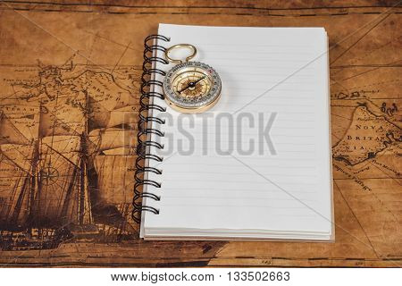 old vintage compass on the note book