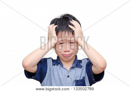 Young Asian boy crying over white background