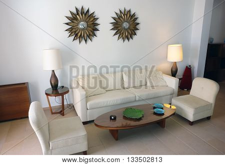 HERAKLION CRETE GREECE - MAY 13 2014: The Interior of light room with table lamps and arm-chairs in modern building of luxury class hotel on the Mediterranean coast of Crete May 13 2014 Greece.