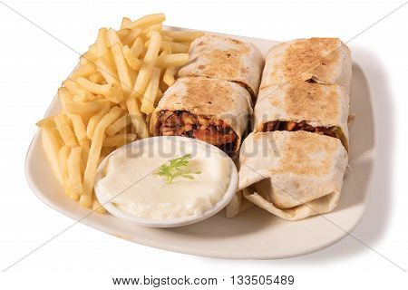 Traditional shawarma wrap with chicken and vegetables French fries and garlic paste in a white plate isolated on white background