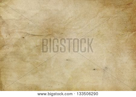 Aged grunge paper background for the design. Old parchment.