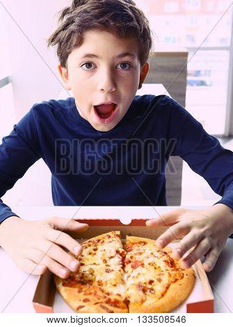 preteen handsome boy with pizza smile portrait