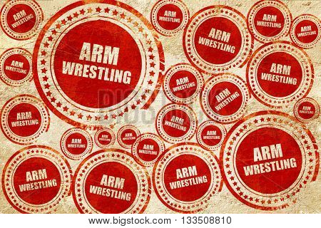 arm wrestling sign background, red stamp on a grunge paper textu