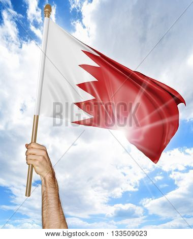 Person's hand holding the Bahraini national flag and waving it in the sky, 3D rendering