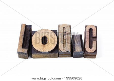 logic word made from scattered wooden letterpress type isolated on white