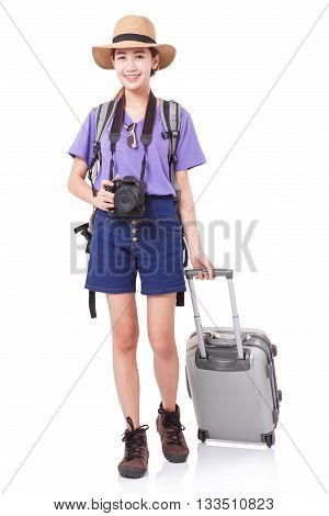 Full length of young woman in casual walking with the travel bag with a camera
