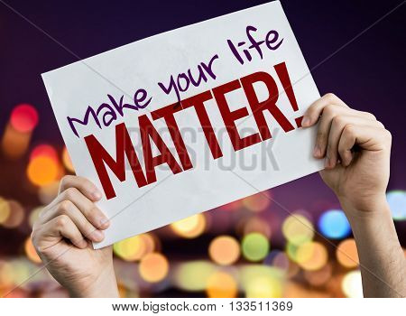 Make Your Life Matter! placard with night lights on background