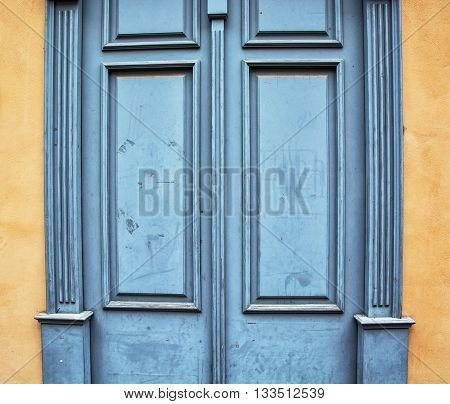 Old wooden blue doors. Vintage architecture element. Retro style. Architectural theme. Locked doors.
