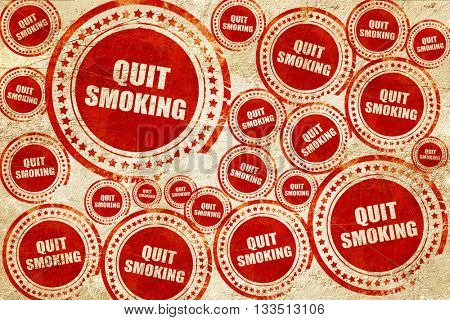 quit smoking, red stamp on a grunge paper texture