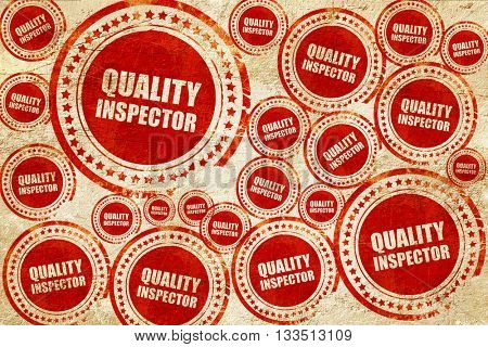 quality inspector, red stamp on a grunge paper texture