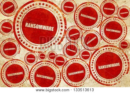 Ransomware, red stamp on a grunge paper texture